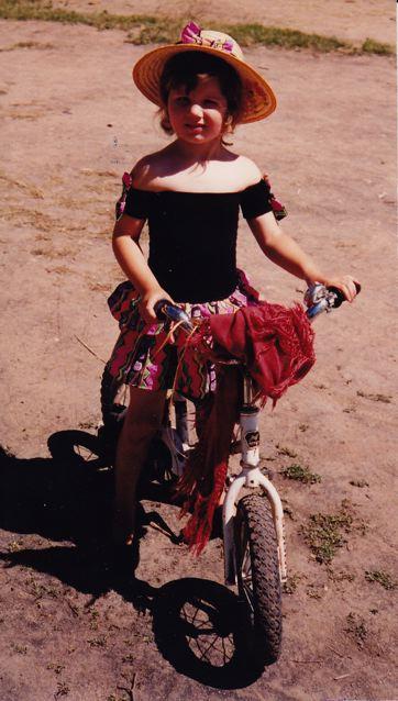 On her bike, 1990