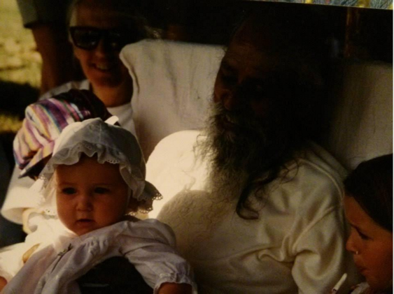 Baby Arpita being held by Babaji