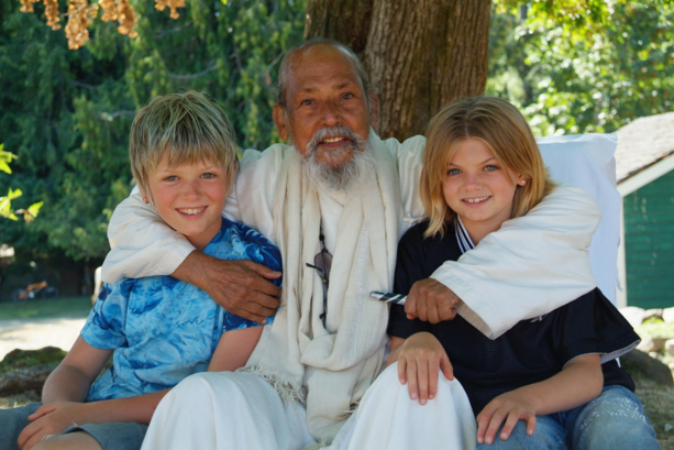 Look at their eyes. I see Love and Happiness. Babaji was so wonderful with Kai and Shael – They are under the maple on the Mound 2008