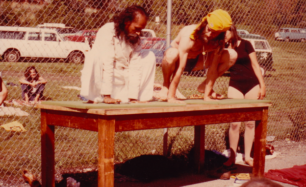 Babaji and AD demonstrating asanas in the tennis court