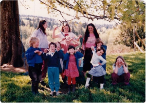 Some of the kids - and a couple of adults -in March, 1984. Back row: Usha, Maicha; front row: Rohan, Kerry, Ariel behind Kerry, Maya, SunMoon, Tzigani, ,Nayana, Sunya behind Nayana, Ananda . Missing from this photo are Rajom, Fainne and Uma. Between Usha and Maicha is someone we can't identify; if you know who it is, please let us know.