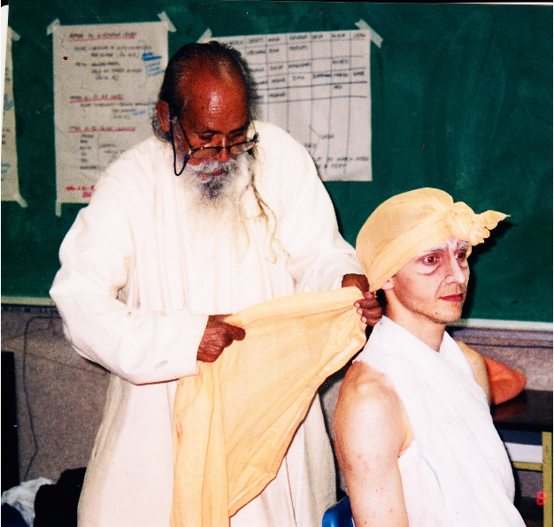 Babaji tying Caleb's turban. Caleb played the part of the hermit. 1999