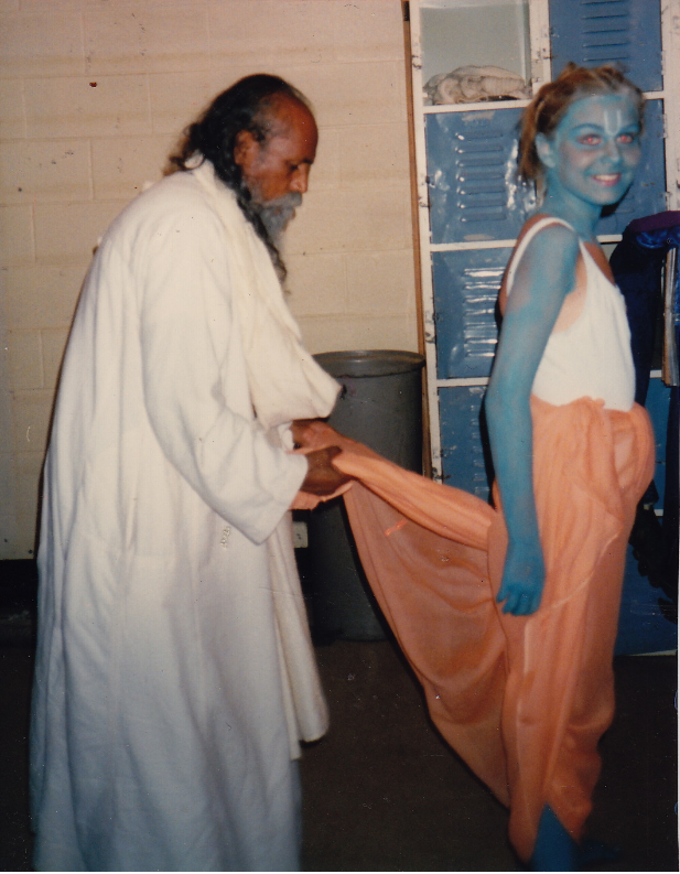 Babaji tying Arianna's dhoti. She played the part of Rama in 1988.